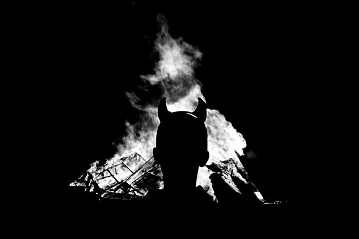 Joyrider. Youth in front of bonfire.